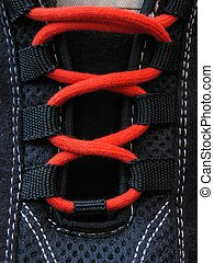 Close up of sneakers with red laces