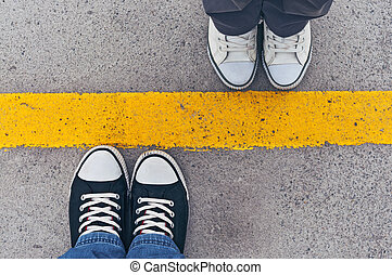 Sneakers from above. Male and female feet in sneakers from ...
