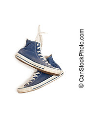 sneakers hanging on the wall - sneakers hanging on the white...