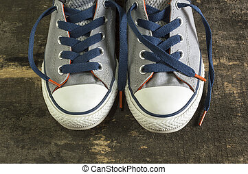 Sneakers on an old wooden surface.