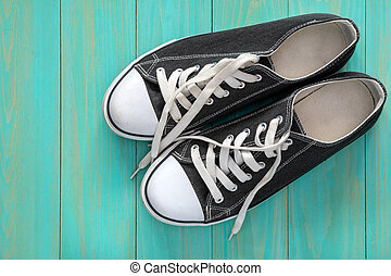 Sneakers on blue wooden background