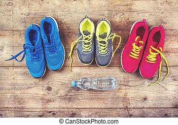 Sneakers on the floor - Various pairs of colorful sneakers ...