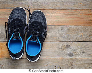 Sneakers on wooden background top view