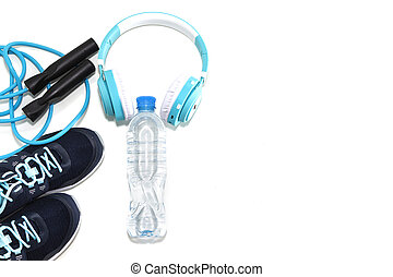sneakers, water bottle and jump rope, audio headphones on a light white background.