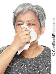 sneezing mature woman