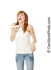 Sneezing - Teen woman holding tissue and sneezing, isolated...