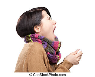 Sneezing young attractive woman holding wipe in her hands,...