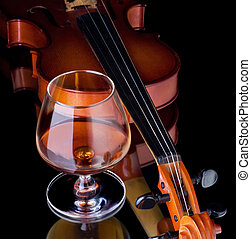 Snifter glass of cognac and violin