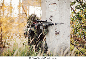 sniper aiming through the scope