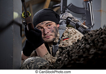 Sniper in waiting position