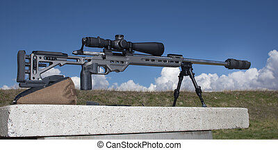 Sniper rifle with scope and silencer