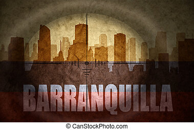 sniper scope aimed at the abstract silhouette of the city with text Barranquilla at the vintage colombian flag. concept