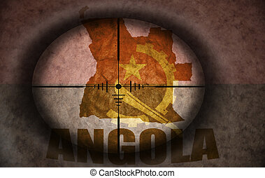 sniper scope aimed at the vintage angolan flag and map