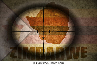 sniper scope aimed at the vintage zimbabwean flag and map