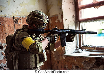 sniper with automatic rifle by the window in building