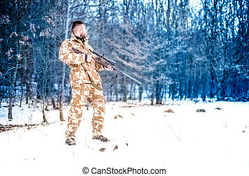 Sniper with weapon ready for combat, special forces army ranger preparing to fire a rifle