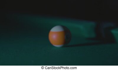 snooker ball with number thirteen get into the billiard pocket