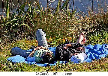 Snoozing couple - After a picnic