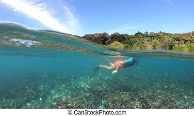 Snorkel Seychelles split view - Split view of female apnea...