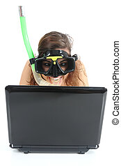 Snorkel woman websurfing in a netbook computer