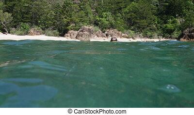 Snorkeler pretending to walk underwater - A man looking at...