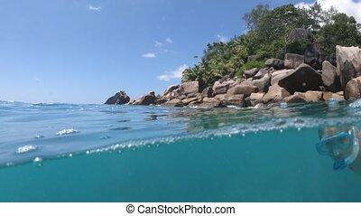 Snorkeling anse Georgette split view - Split view of female...
