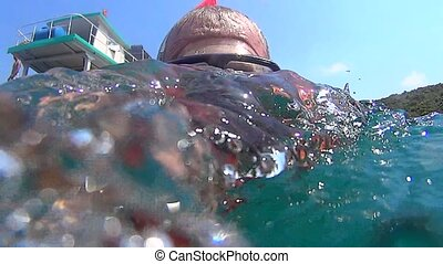 Snorkeling - Close-up of a man with a mask  under water.