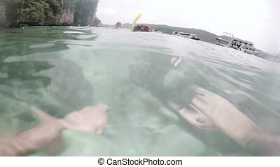 Snorkeling romantic couple hold hand in han underwater sea