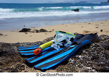 Snorkeling, Swimming, Diving Equipment on the rock beach.