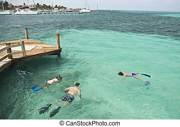 Snorkling - Three snorklers off the dock at Ramon\'s Village...