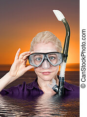 Snorkling - Woman in clothes in water with a snorkle and...