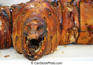 snout of pork cooked on a spit for sale in an Italian butcher