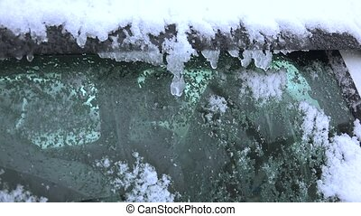Snow and ice on the windshield of a car. 4K.