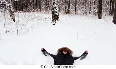 Snow angel in the forest
