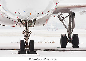 Snow at the airport - Aircraft covered by snow after a snow...