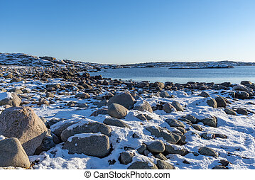 Snow at the beach in winter