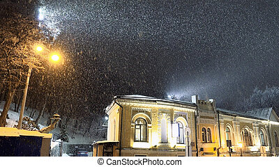 Snow blizzard in the night city