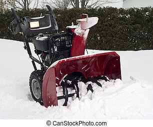 snow blower in the snow in winter