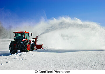 Snow Blower - Snow is being removed by a snow blower.