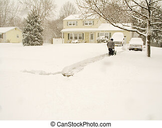 Snow Blower - This is a shot of a man using a snow blower ...