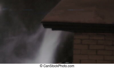 Snow blowing off a rooftop - Establishing shot of snow...