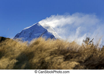 Mount Cook - snow blowing over the top of Mount Cook at...