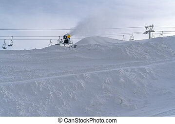Snow cannon and chair lifts in Park City Utah. Snow cannon...