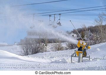 Snow cannon at work on a ski resort in Park City. Snow canon...