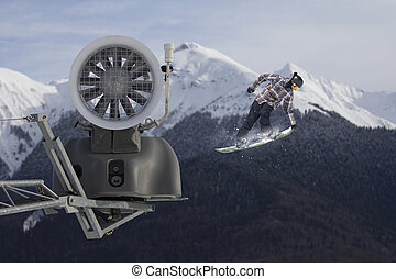 Snow cannon in the mountain ski resort and the flying...