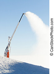 Snow cannon making artificial powder at the very top of a...