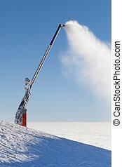 Snow cannon making artificial snow powder on a mountain ski...