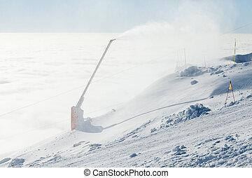 Snow cannon making powder on a mountain ski slope - Snow...