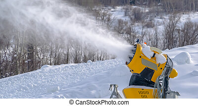 Snow cannon on a mountain in Park City Utah. Bright yellow...