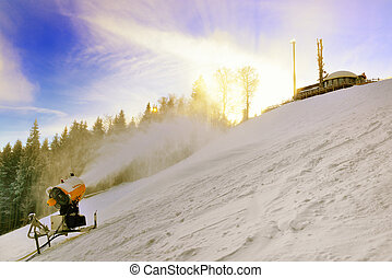 Snow cannon prepares ski slope high in the mountains at...